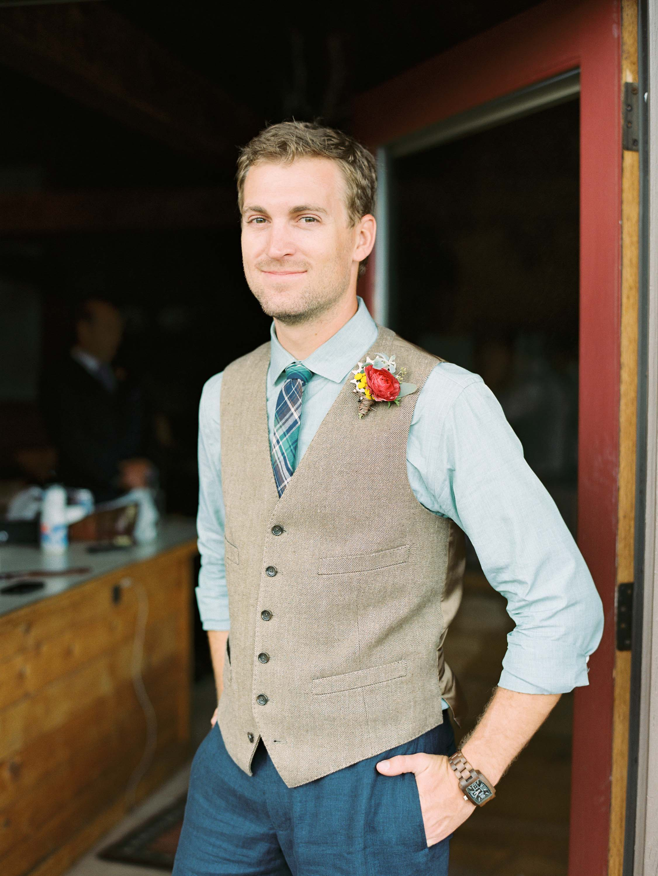 Flowers by Lace and Lilies, bike gear and pink ranunculus - tan vest groom - mountain wedding