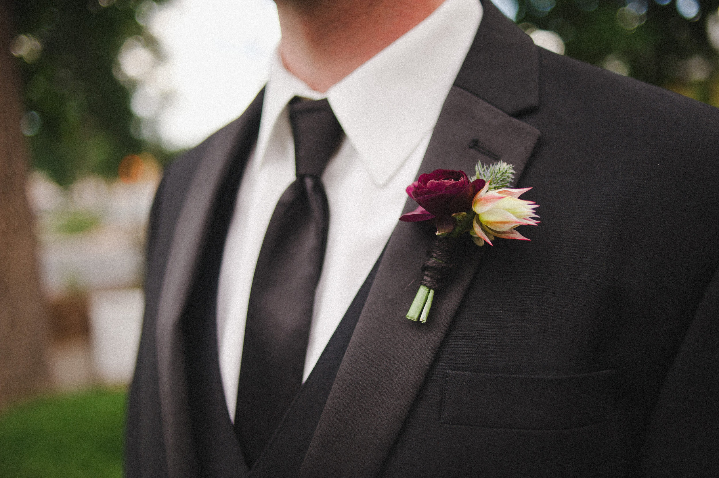 Flowers by Lace and Lilies, Burgundy Ranunculus, Blue Thistle and Blushing Bride boutonniere, black tie tux wedding