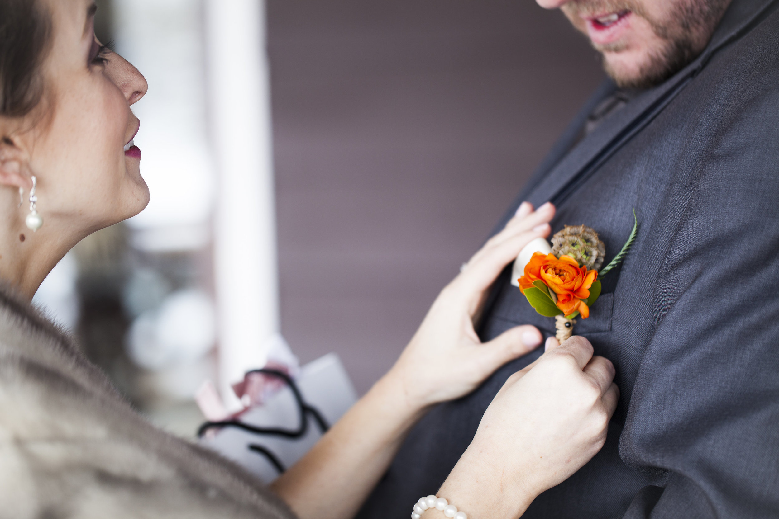 Flowers by Lace and Lilies, orange ranunculus and scabiosa pod boutonniere, summer bright and colorful wedding