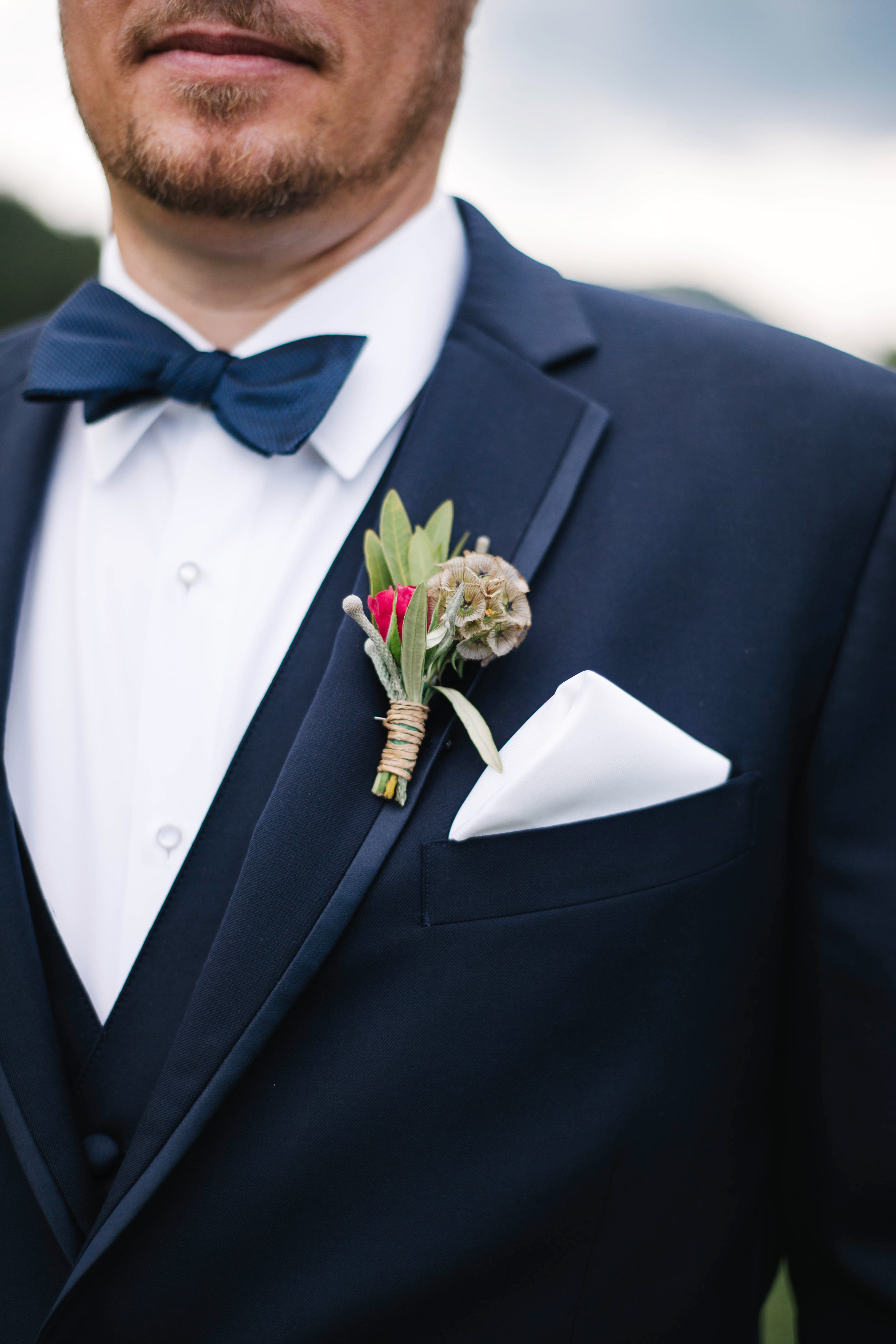 Flowers by Lace and Lilies, manly and mountainous boutonniere, grey tux with bow tie - scabiosa pod