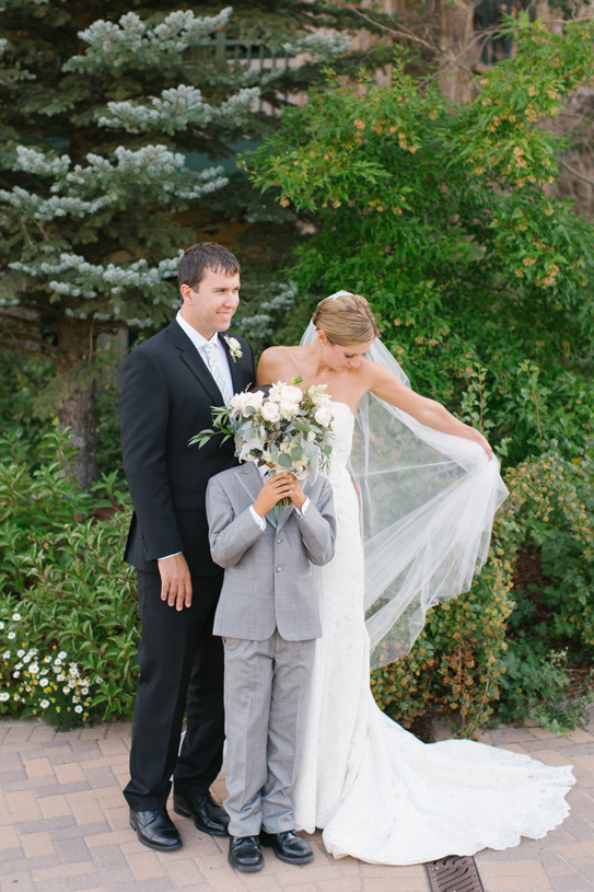 Flowers by Lace and Lilies. Bouquet and Boutonniere / Steamboat Springs, CO - White, Ivory, Blush, Gray, Dusty Green, Sage Green. Soft, Romantic, Timeless, Classic, Elegant. Bride, Groom, Best Man, Family. Calcynia, Blushing Bride, Eucalyptus, Silver Brunia Berry / Berries, Dusty Miller, Garden Rose, Dahlia