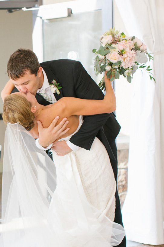 Flowers by Lace and Lilies. Bridal Bouquet and Boutonniere / Steamboat Springs, CO - White, Ivory, Blush, Gray, Dusty Green, Sage Green. Soft, Romantic, Timeless, Classic, Elegant. Bride, Groom, Kiss, Marriage, Wedding. Calcynia, Blushing Bride, Eucalyptus, Silver Brunia Berry / Berries, Dusty Miller, Garden Rose, Dahlia