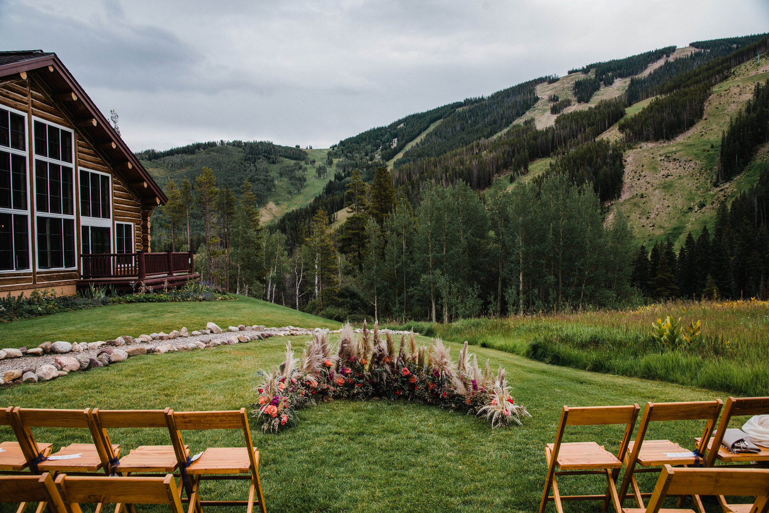 Flowers by Lace and Lilies, Beaver Creek wedding at Beano's Cabin - ceremony flower circle with bold colors and pompous grass