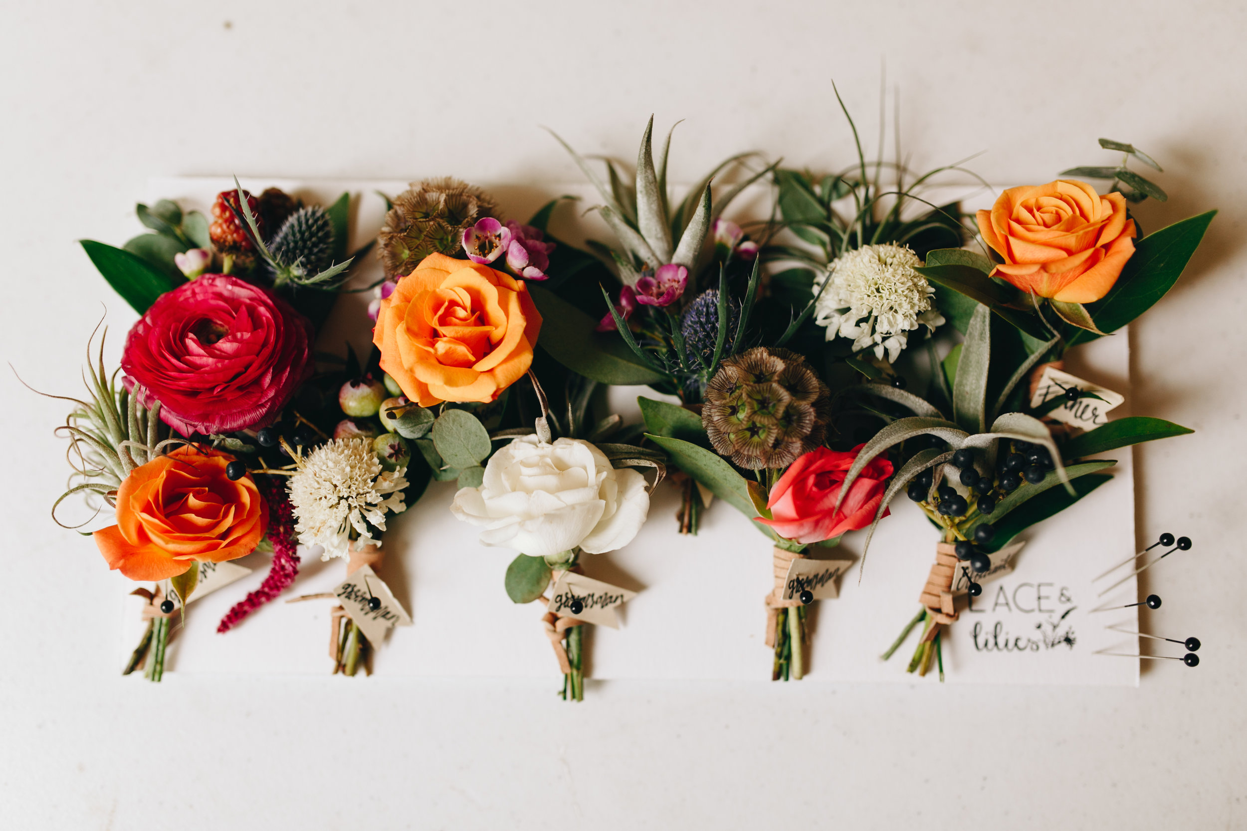 Flowers by Lace and lilies, jewel tones, colorful, bridal bouquet, hair crown, plants and flowers, colorful arch, castle wedding, colorado wedding, dunafon castle wedding, boutonnieres