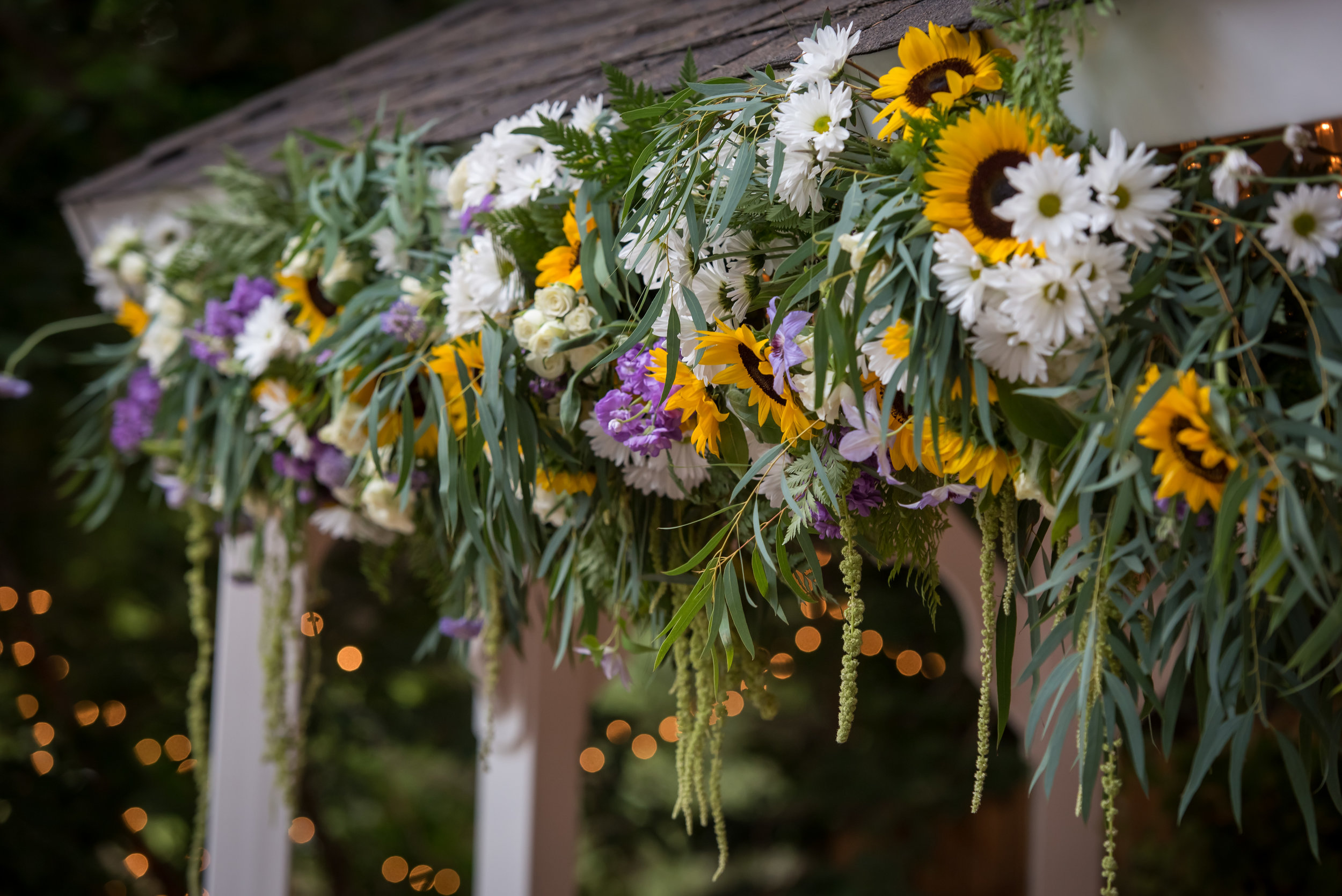 Flowers by Lace and Lilies, ceremony flowers, denver wedding, arch flowers, colorful bloom, sunflowers, yellow and purple wedding, ceremony decor
