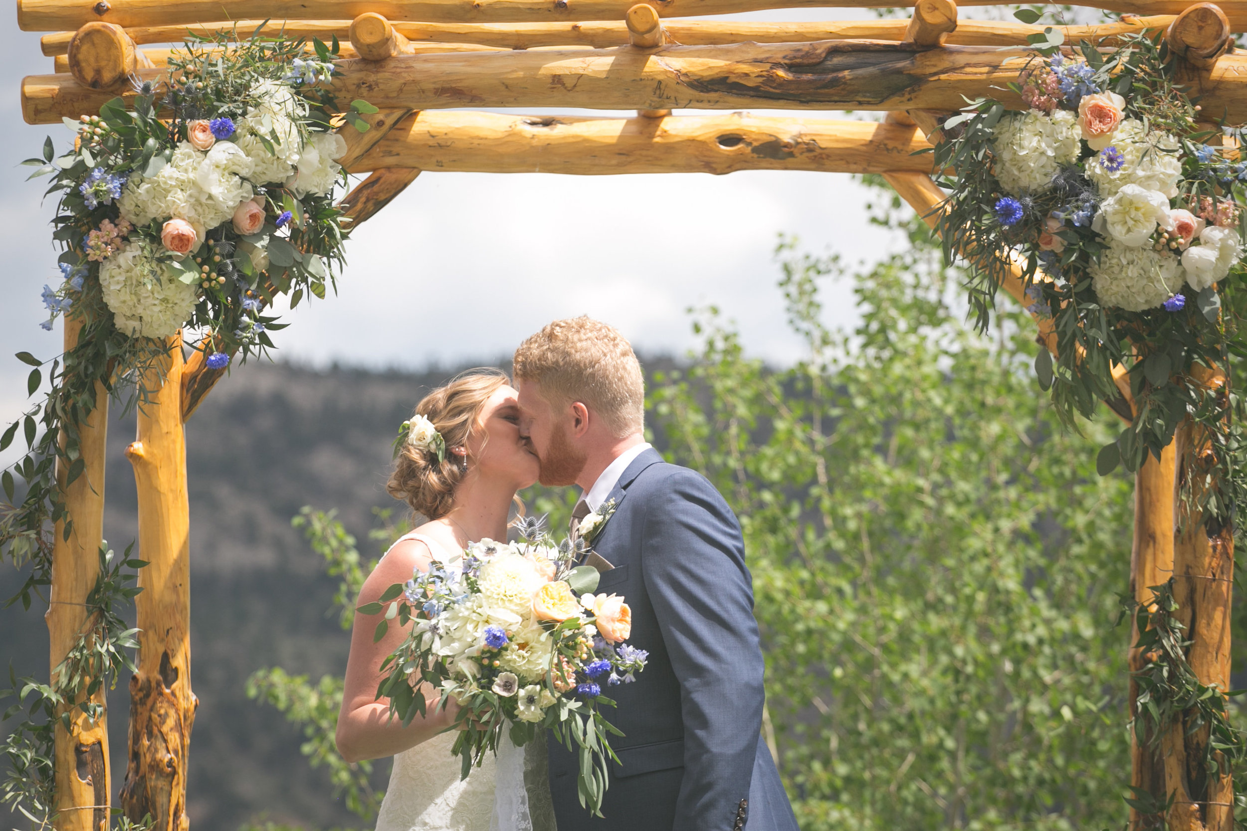 Flowers by Lace and Lilies, ceremony flowers, denver wedding, arch flowers, colorful bloom, wooden arch, ceremony decor, marys lake lodge, estes park wedding