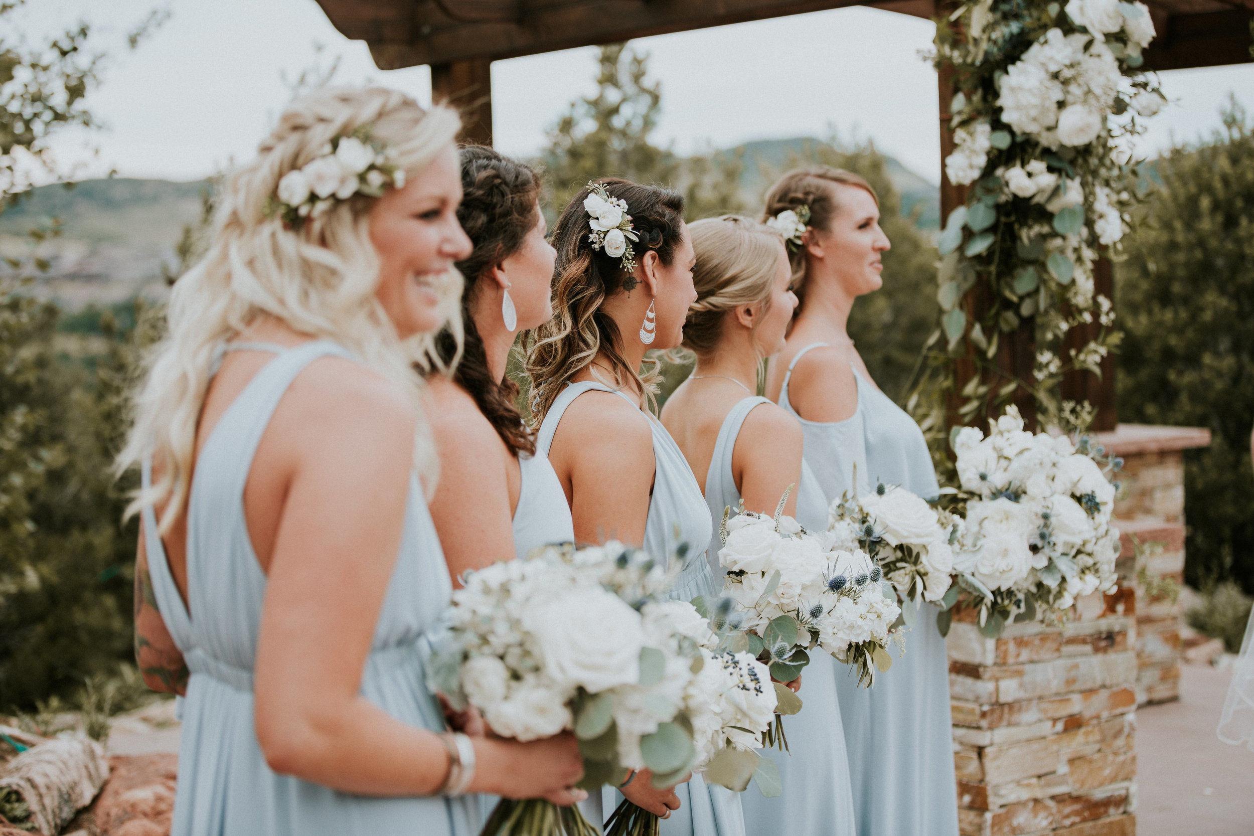 Flowers by lace and lilies, greenery, blue bridesmaid dresses, dusty blue