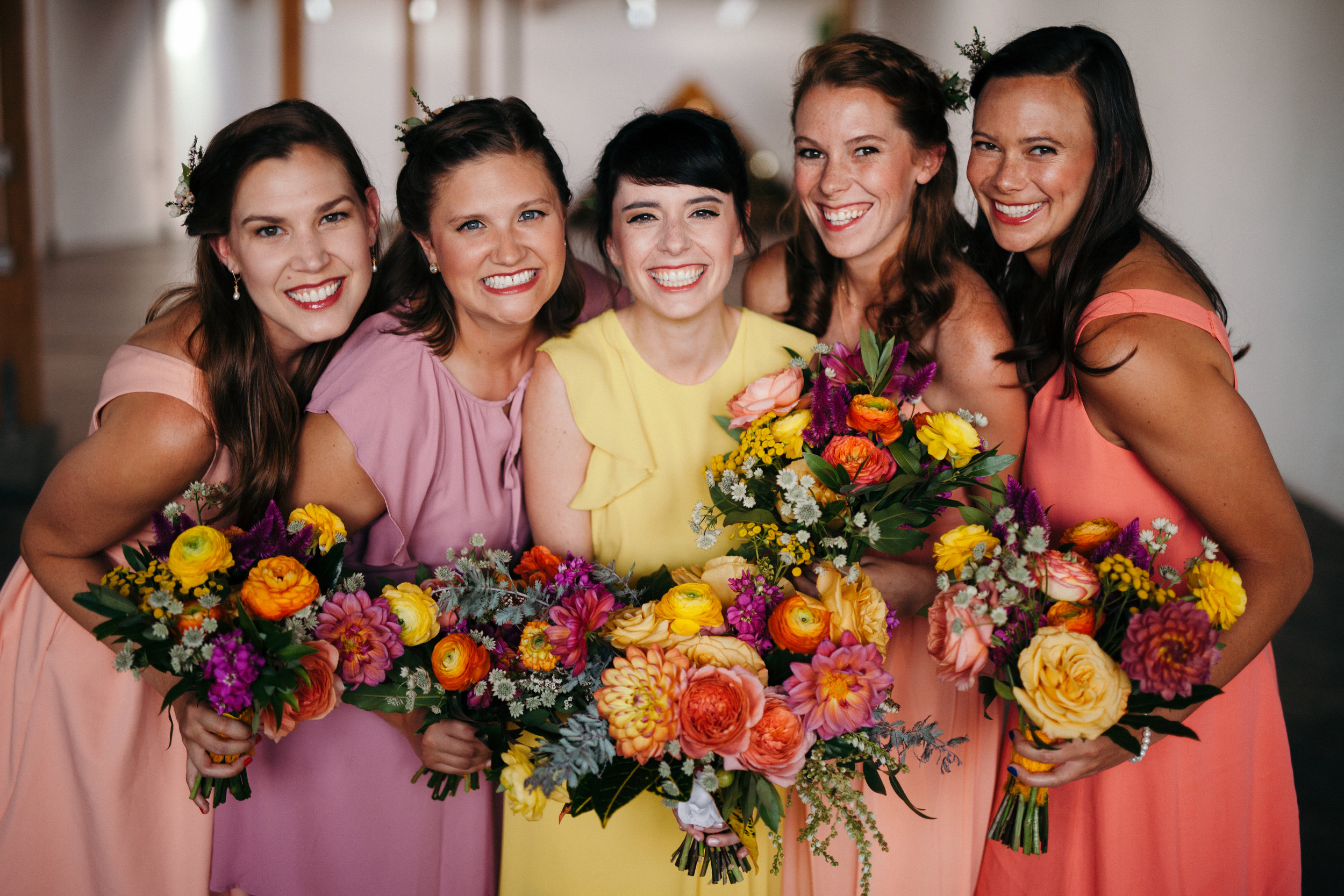 Flowers by Lace and Lilies, colorful bouquets, bridesmaid dresses, bridal bouquet, bridesmaid bouquets, colorado wedding, mountain wedding, coral wedding flowers, peach and yellow