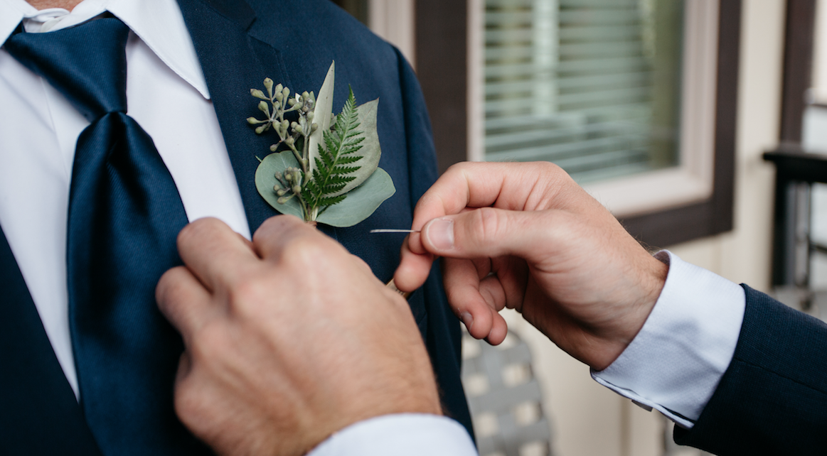 Flowers by Lace and Lilies, wedding flowers, blush flowers, bridal bouquet, colorado wedding, blush and white wedding, eucalyptus, greenery, foliage, boutonniere, greenery boutonniere, texture, boutonniere, how to pin a boutonniere, greenery boutonniere, navy suit