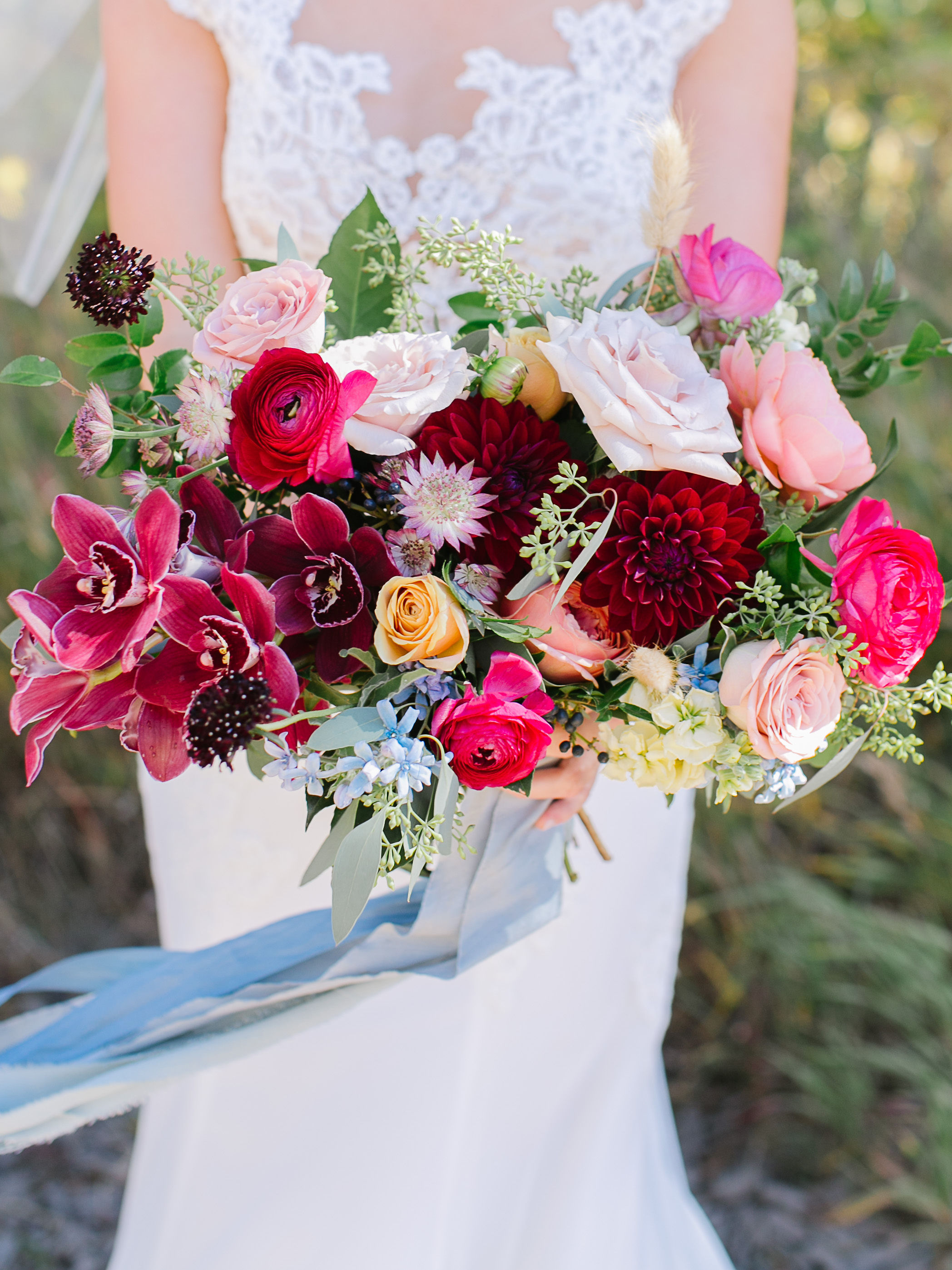 Flowers by Lace + Lilies, bridal bouquet, color palette, mountain wedding, vail wedding, burgundy flowers, yellow flowers, fall palette, fall wedding, raspberry flowers, draping ribbon, trailing ribbon, flowers, wedding flowers