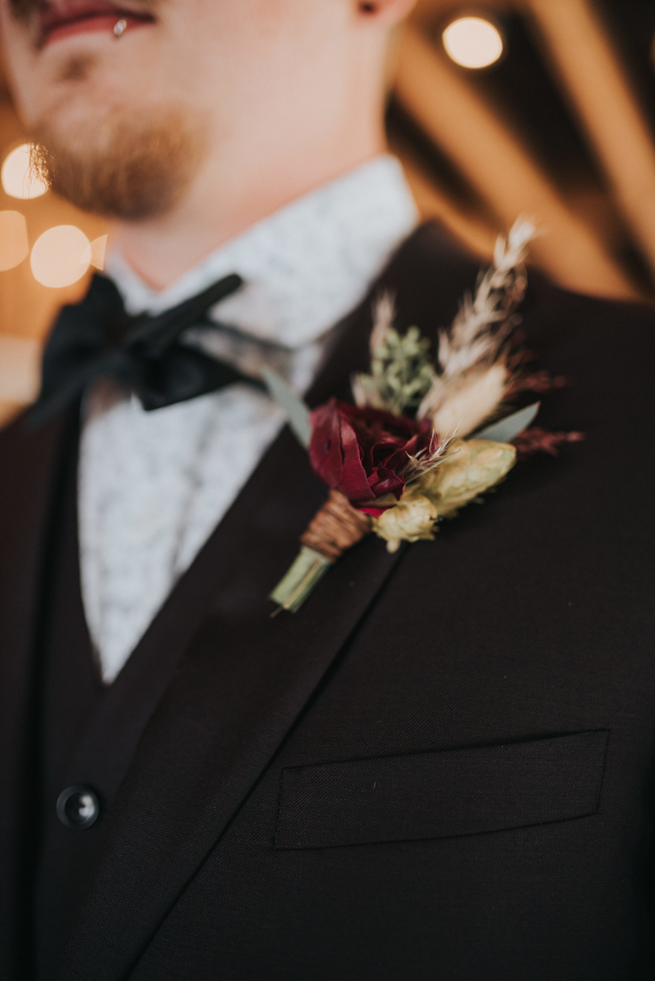 Flowers by Lace and Lilies, bridal bouquet, moody flowers, burgundy wedding, dusty colored wedding, pampas grass, lyons farmette wedding, colorado wedding, anemone, amnesia roses, boutonniere, groom boutonniere, groom suit