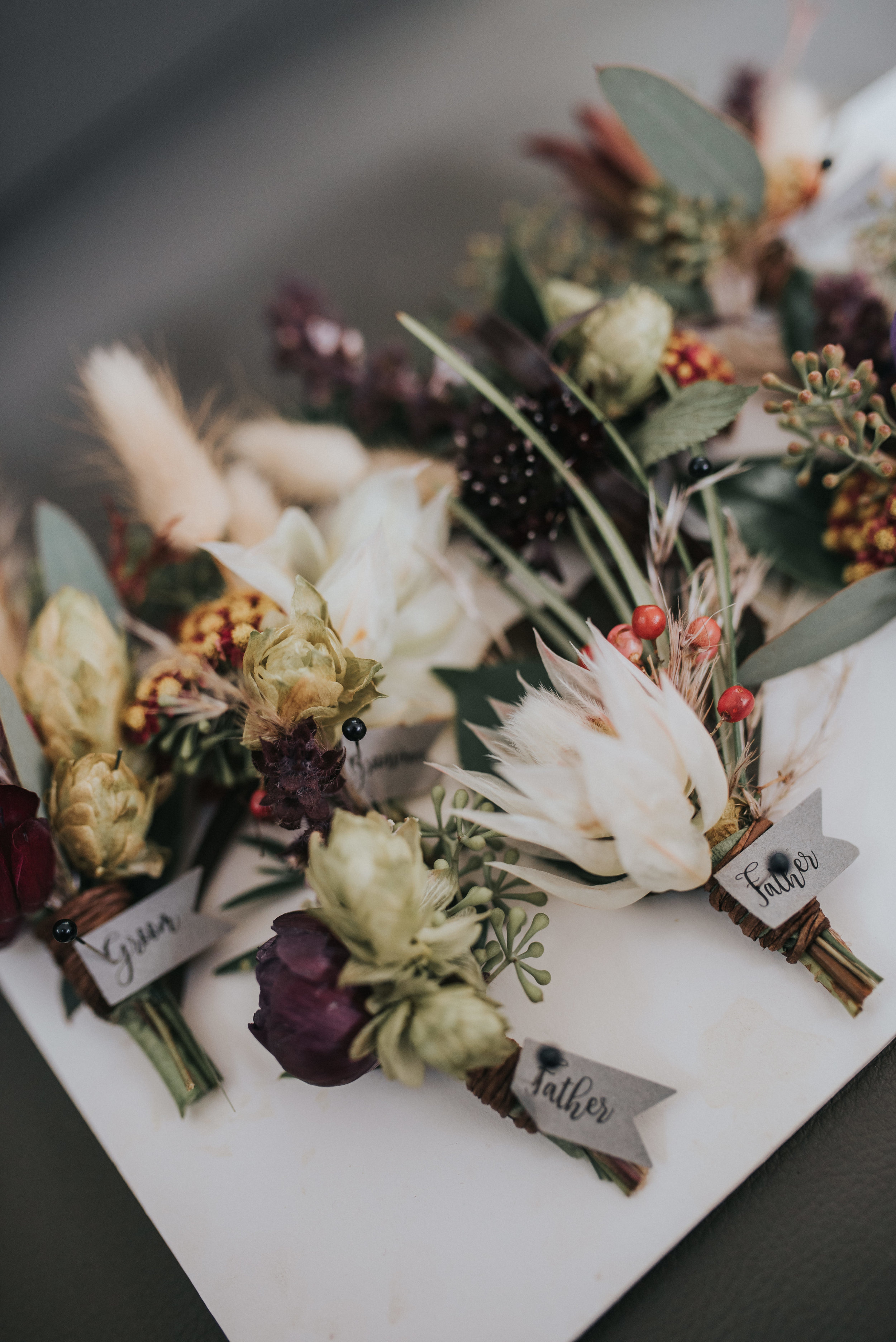 Flowers by Lace and Lilies, bridal bouquet, moody flowers, burgundy wedding, dusty colored wedding, pampas grass, lyons farmette wedding, colorado wedding, anemone, amnesia roses, boutonniere, groom boutonniere, texture, bride and groom, first look, wedding photography, flower crown, jewel tones, big floral crown
