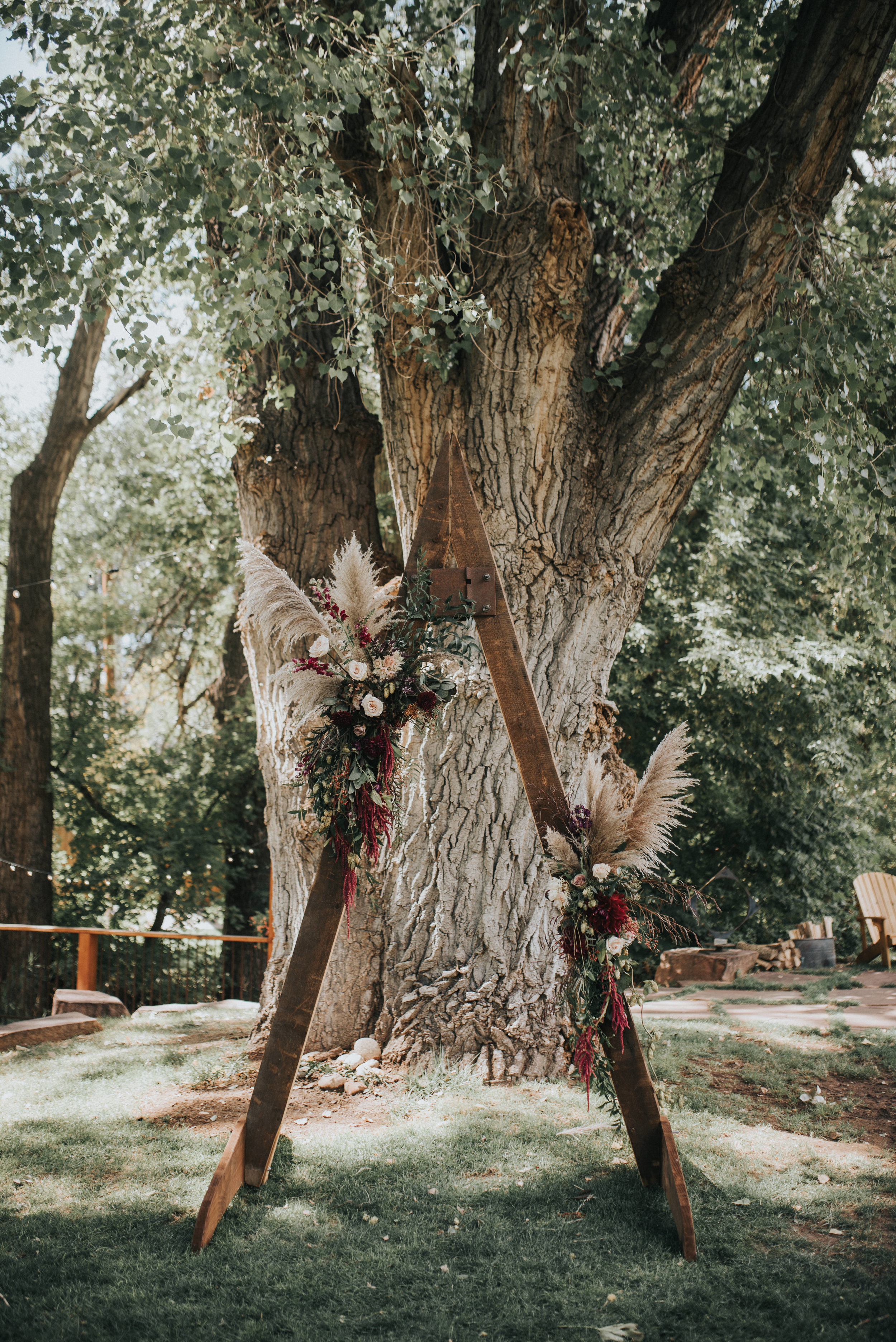 Flowers by Lace and Lilies, boutonniere, wedding flowers, jewel tones, pampas grass, hops, texture, colorado wedding, a-frame arch, arch flowers, altar flowers, ceremony flowers, moody toned wedding, pampas grass