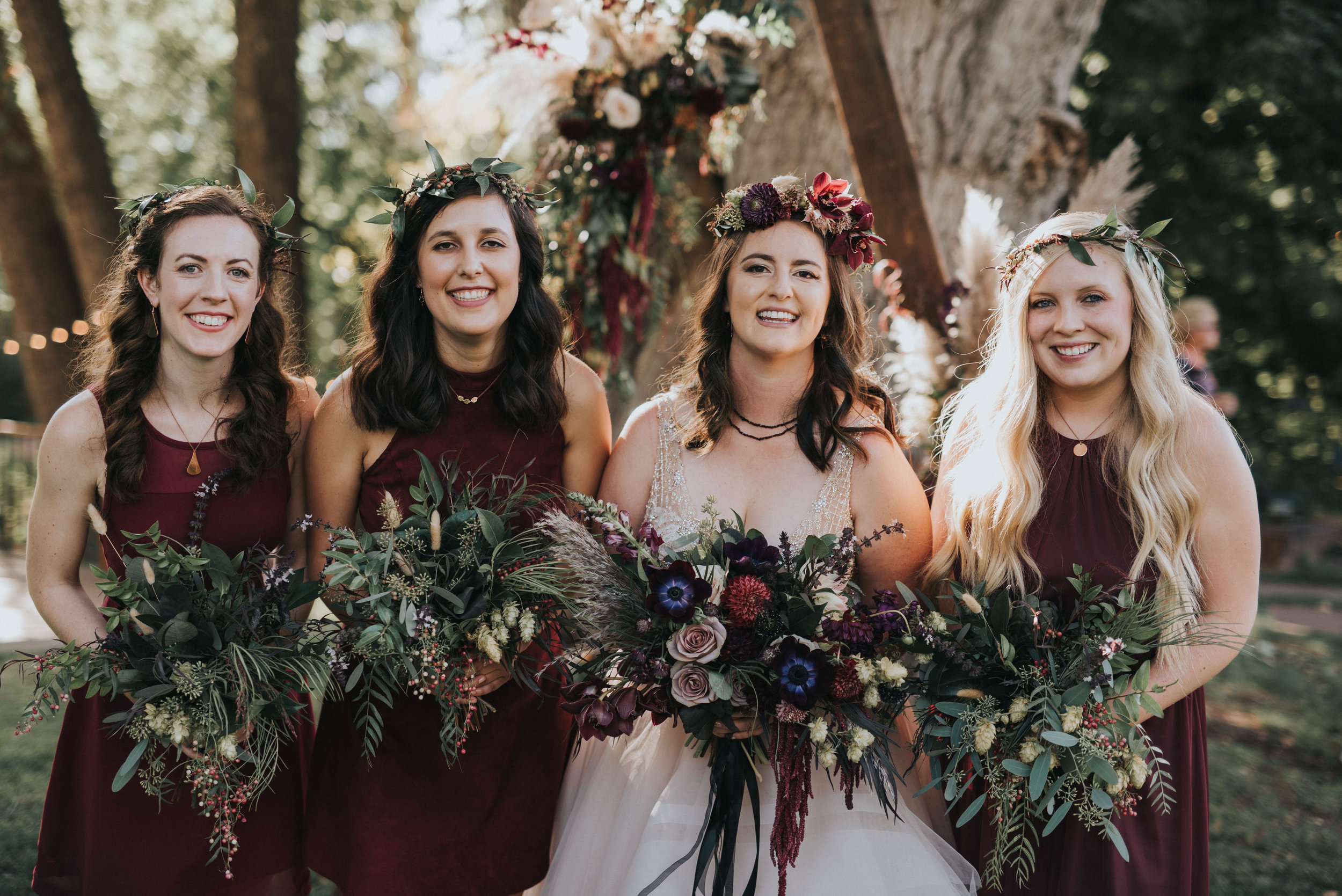 Flowers by Lace and Lilies, boutonniere, wedding flowers, jewel tones, pampas grass, hops, texture, colorado wedding, a-frame arch, arch flowers, altar flowers, ceremony flowers, moody toned wedding, pampas grass, bridal party, burgundy dresses, foliage bouquets, flower crowns
