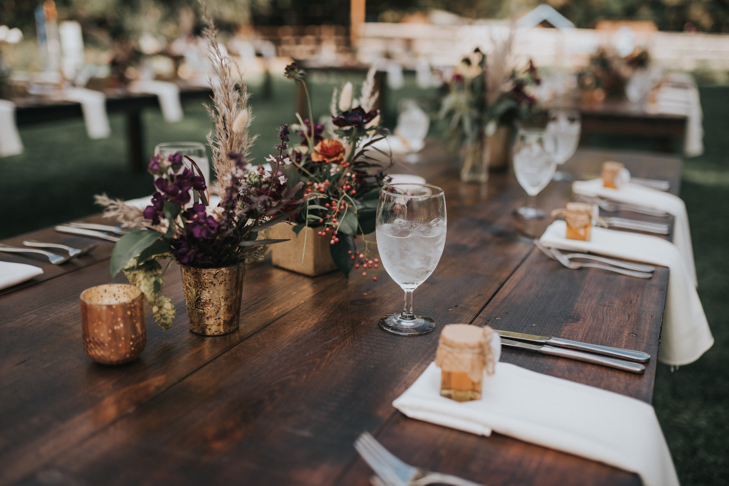 Flowers by Lace and Lilies, boutonniere, wedding flowers, jewel tones, pampas grass, hops, texture, colorado wedding, a-frame arch, arch flowers, altar flowers, ceremony flowers, moody toned wedding, pampas grass, bridal party, burgundy dresses, foliage bouquets