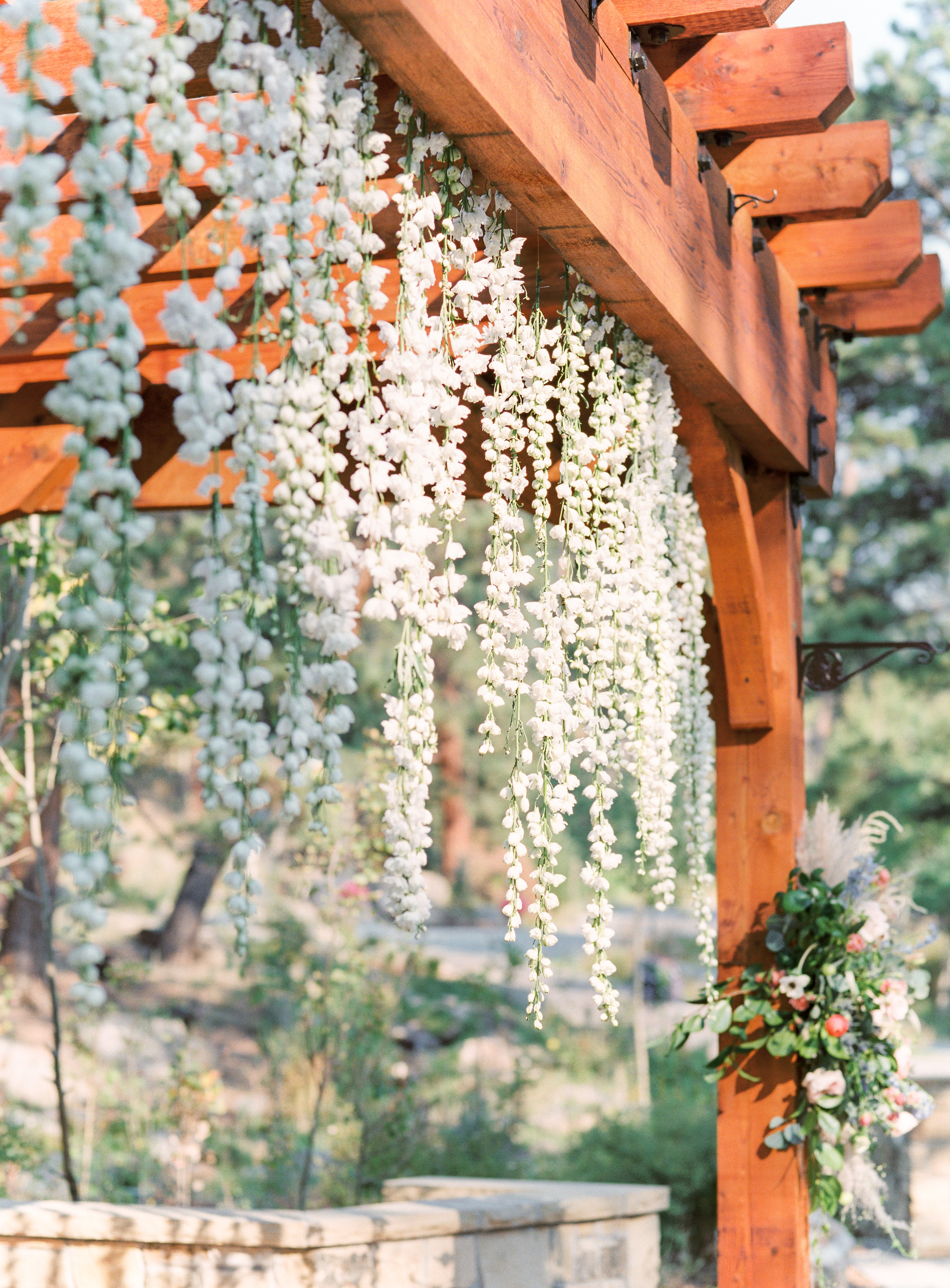 Flowers by Lace + Lilies, bridal bouquet, hanging flowers, floral installation, boutonnieres, colorful flowers, greenery, elopement photography, elopement flowers, colorado elopement