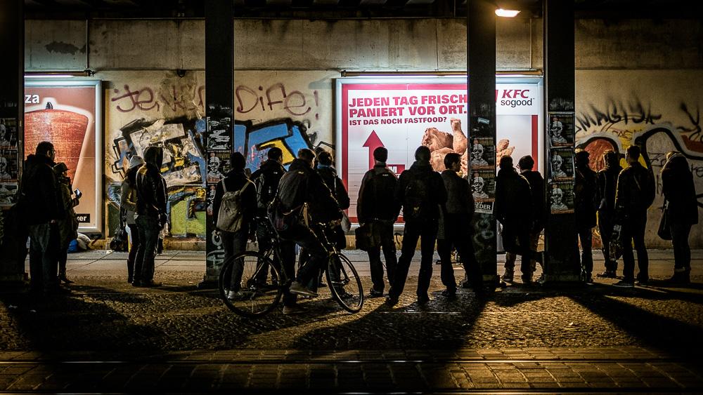 Watching a busker under the Alexanderplatz S-Bahn station