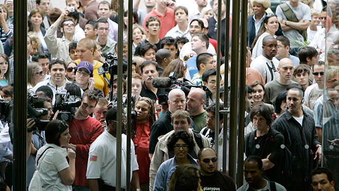 Despite the very pricey US$600 price tag, the iPhone revolutionised the mobile industry by integrating phone, email, music, navigation and other features in a single device. Shown here is the crowd outside Chicago's Michigan Avenue Apple store before the iPhone's launch in 2007 – which saw    lengthy queues of eager consumers    camped outside storefronts around America.