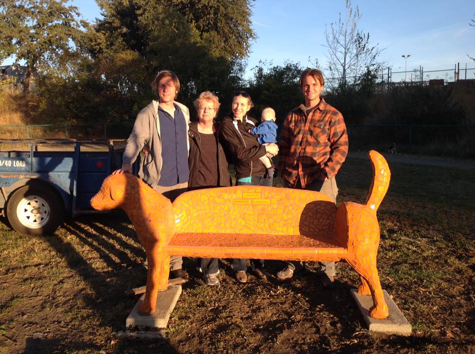 This a Memorial Bench for George Fisher (1949-2014). Artist and Fisher Family gathered for this image on the morning of installation. Located at Toad Hollow Dog Park in Davis, California.