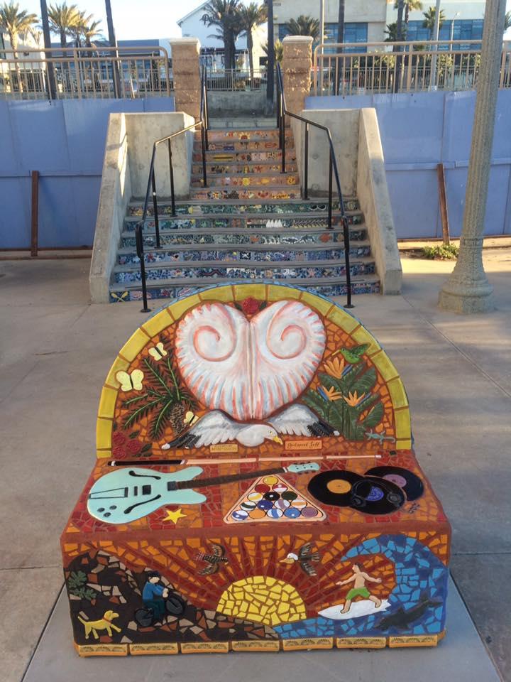 """Ocean Heart"" a public memorial bench for Jeffrey Cullen located near the Jr. Lifeguard Building on Huntington Beach, CA oceanfront boardwalk. 2016"