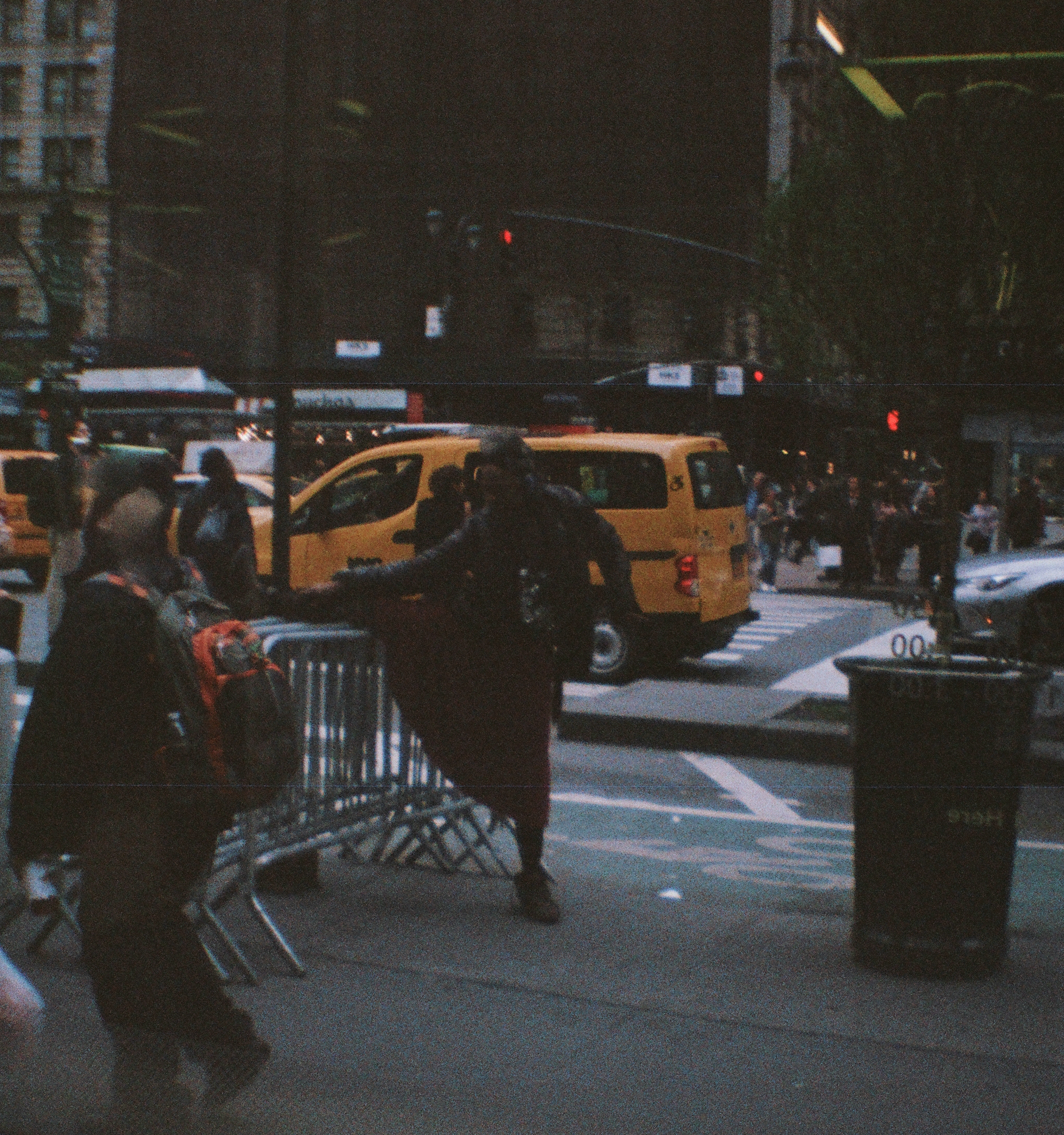 Stretching, NYC. 35mm. Diana Mini. Fujifilm Superia 400.