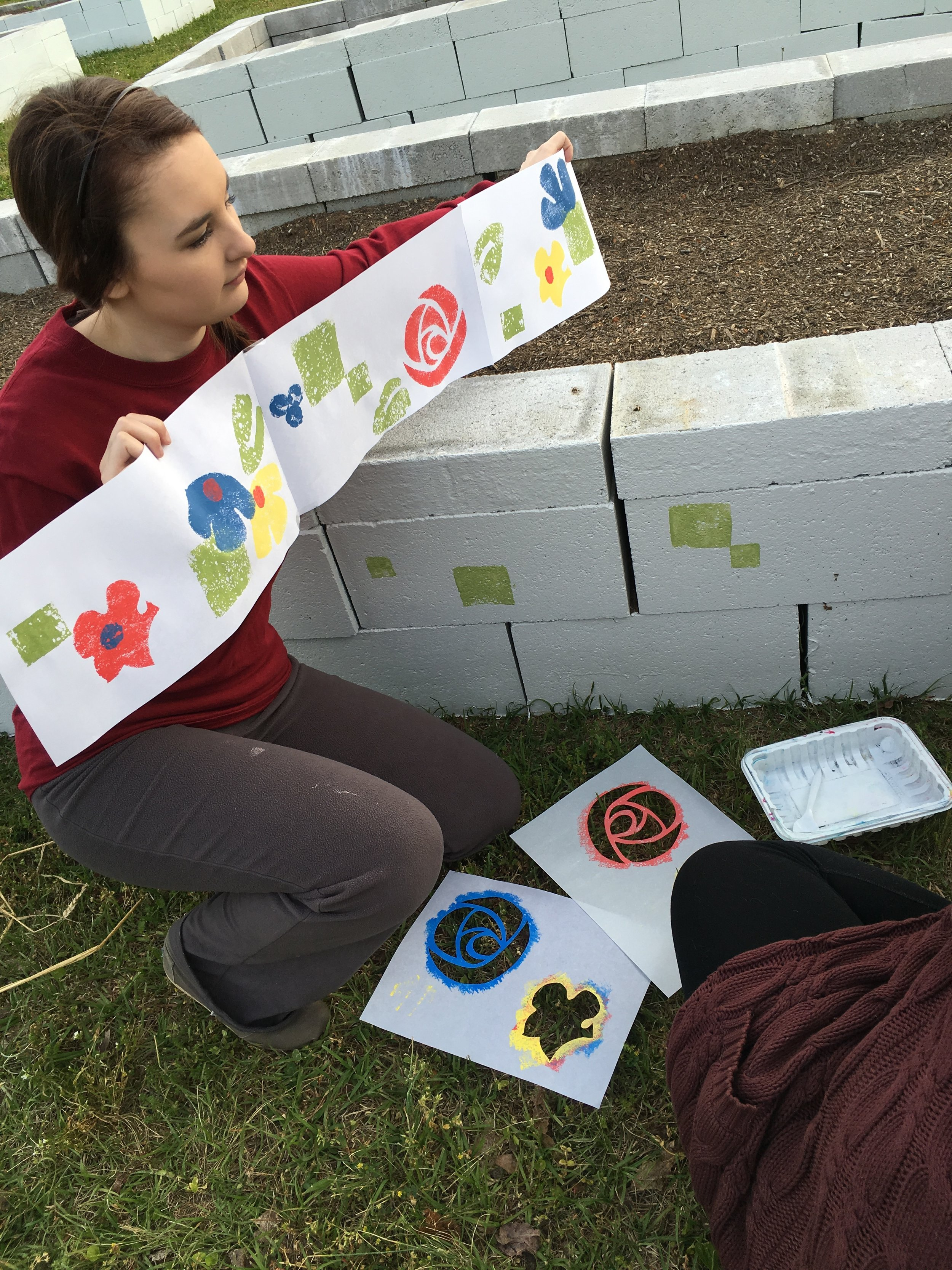 Copy of Students working on the WU Community Garden - floral stencils on the raised beds.