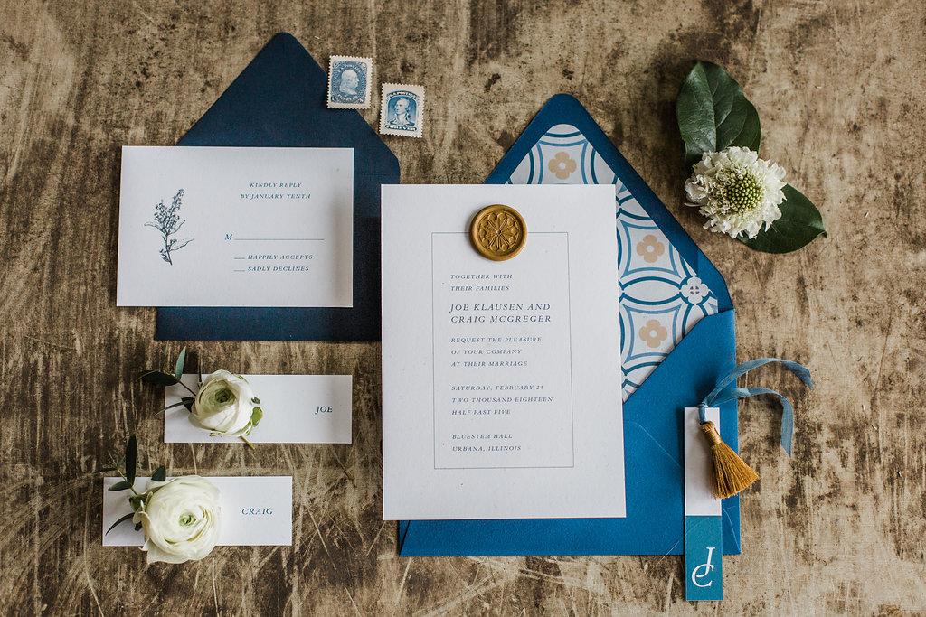 classic wedding invitation with blue and gold details