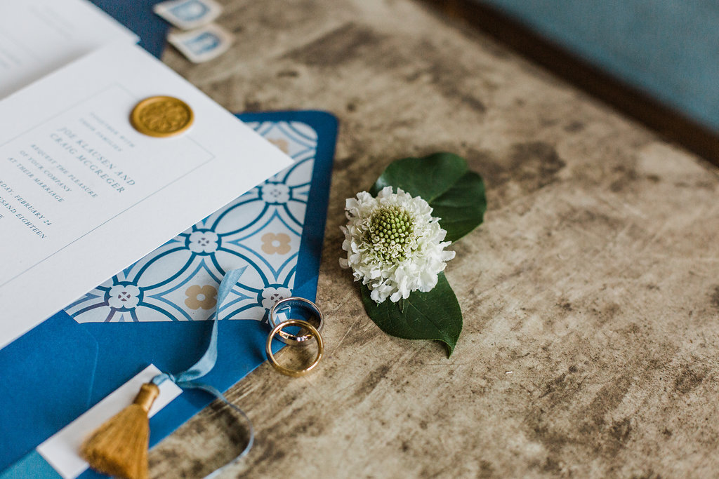masculine wedding invitation with gold wax seal
