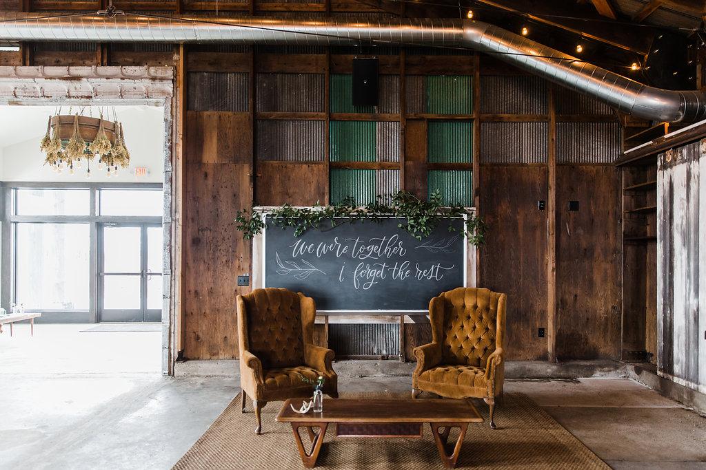 custom chalkboard lettering wedding signage at bluestem hall