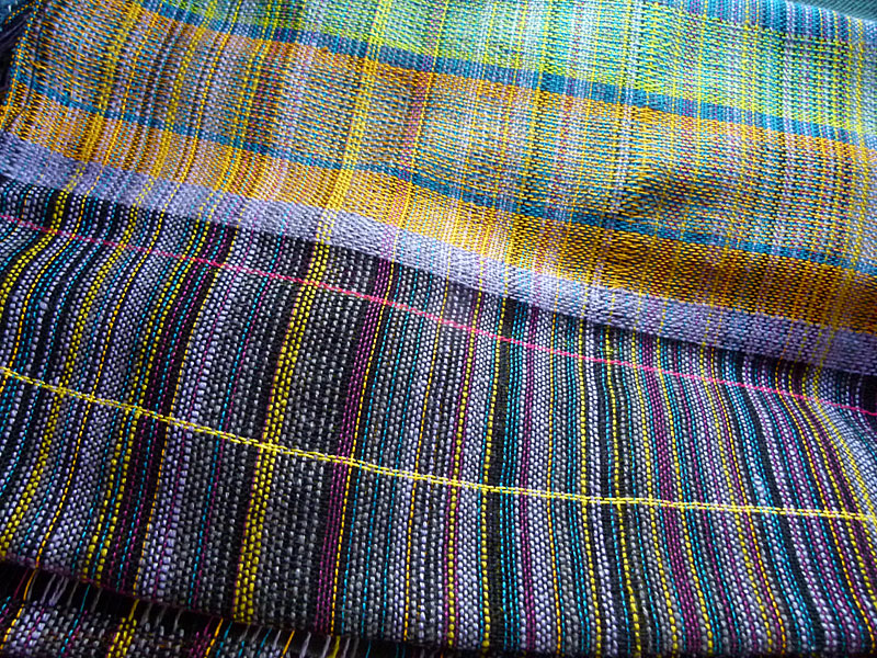 The warp is multi-colored so when I used a black weft it made a rich and wonderful colorful effect.