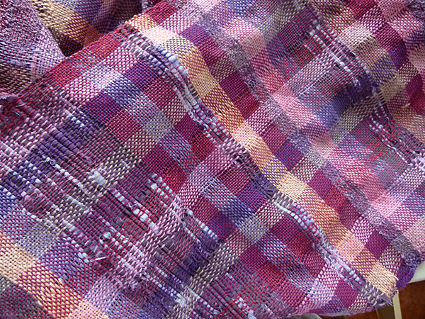 This is the fabric just off the loom. I am pleased with the results. It could have come out looking traditional with the plaid design but it is far from traditional now. I did not count my weft but just eyeballed it so that it would be a natural fit of colors. I see colors as the actors in the play. The come on and off stage and it varies depending on how much emphasis I want to give one player over the other. I suppose only weavers will understand that or maybe that is just my way of making sense of design.
