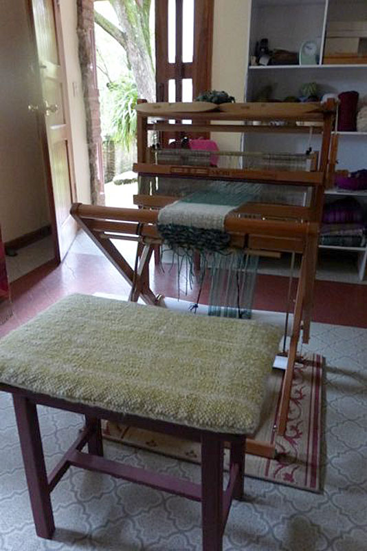 Here is my loom and the cushion I made for the bench.