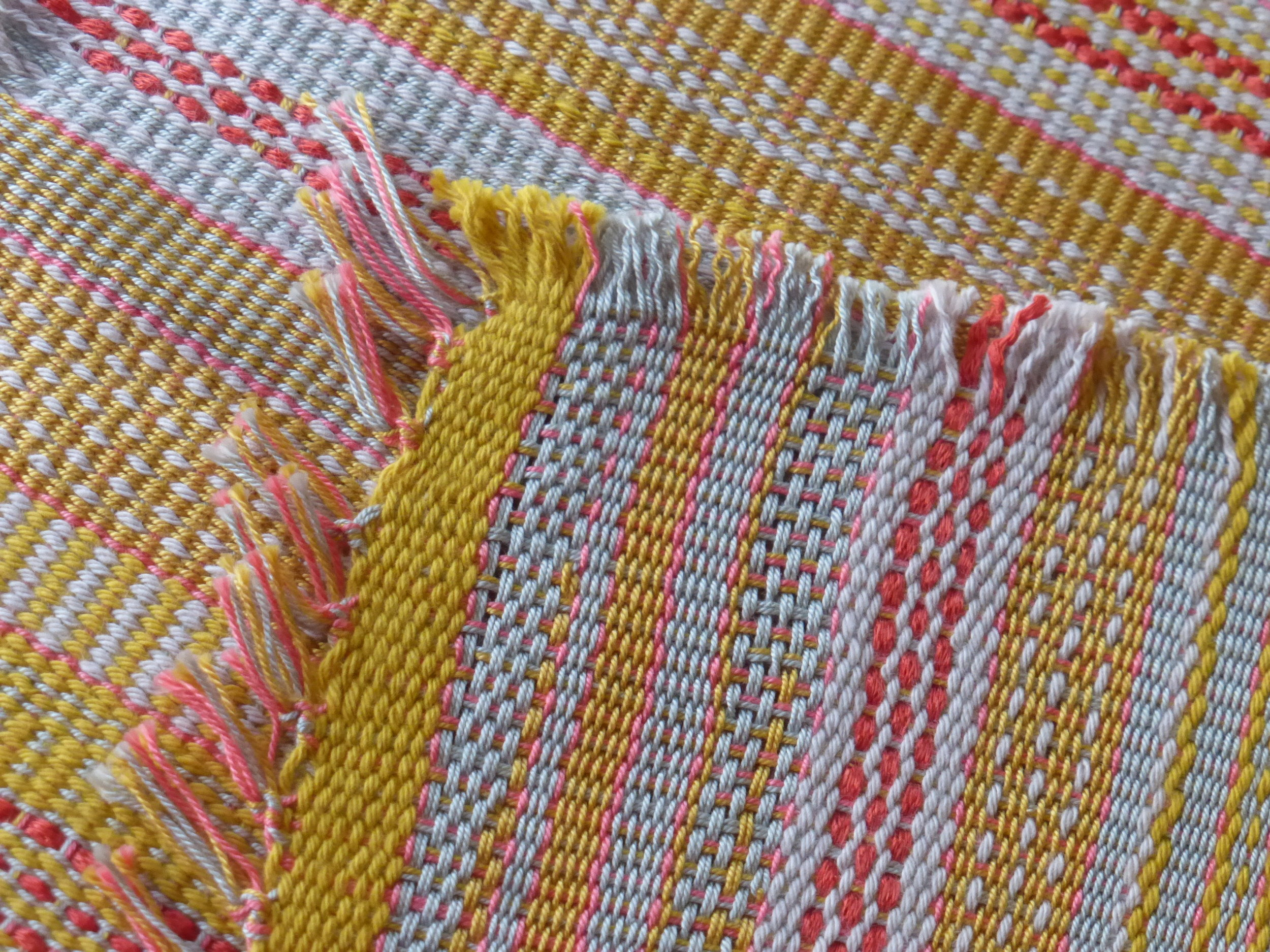 Close up of some of the patterns. The fabric has a nice drape and some shine from the mercerized weft threads.