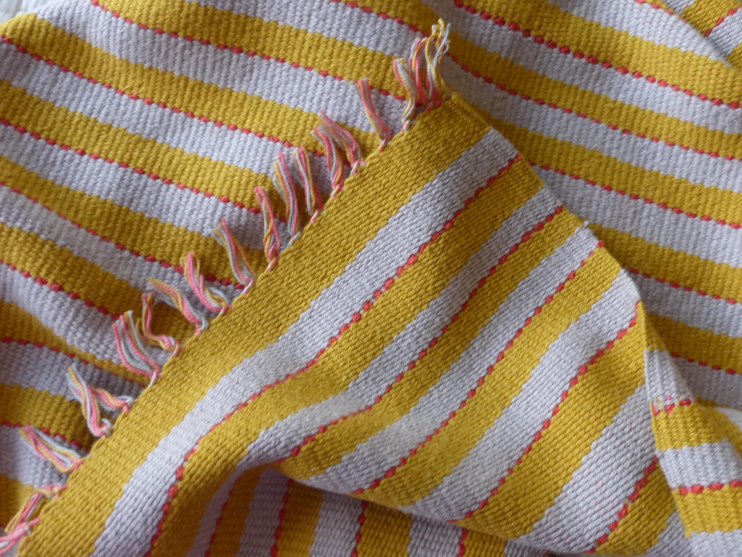 The heavier cotton thread made a thicker, less drapey cloth.