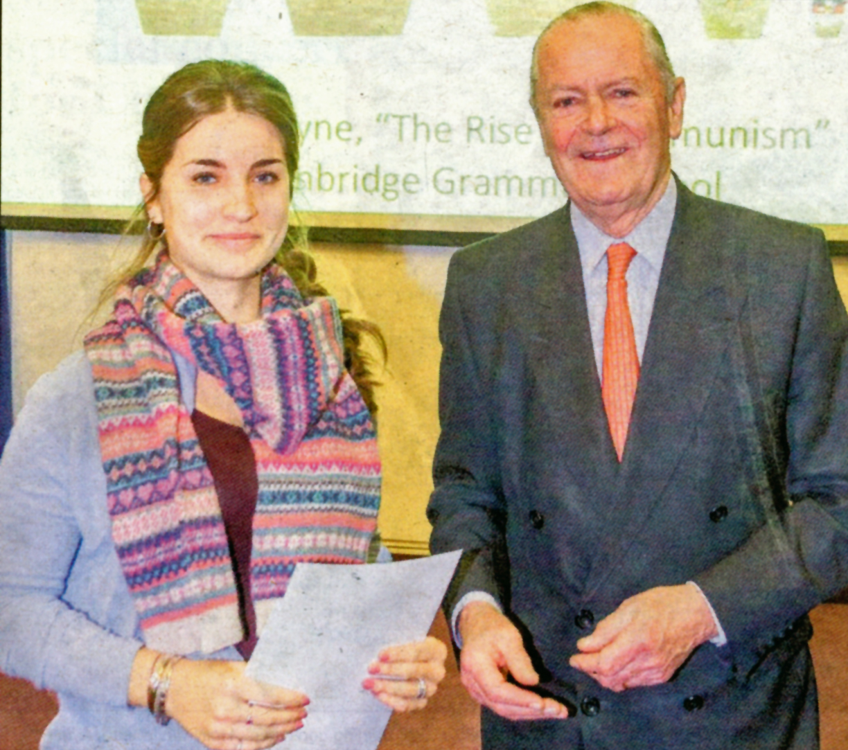 """Amaya Lyne receives her award for her entry """"The Rise of Communism"""" from Mike Hill"""
