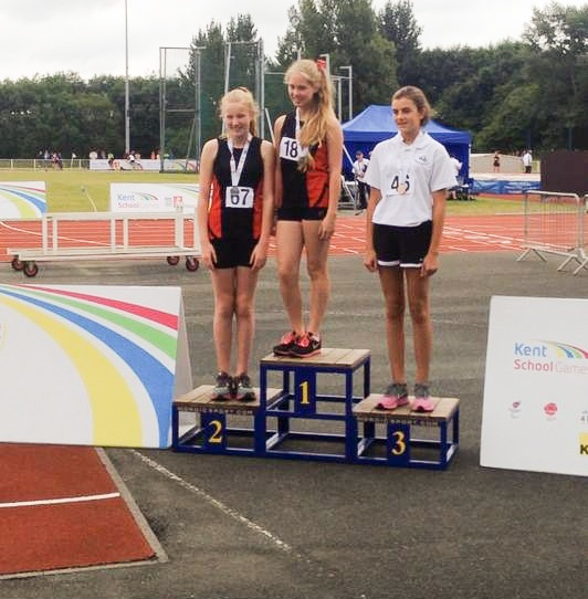 Sydnee and Kirsty-Anne receiving gold and silver medals for the year 7 girls Shot Putt.