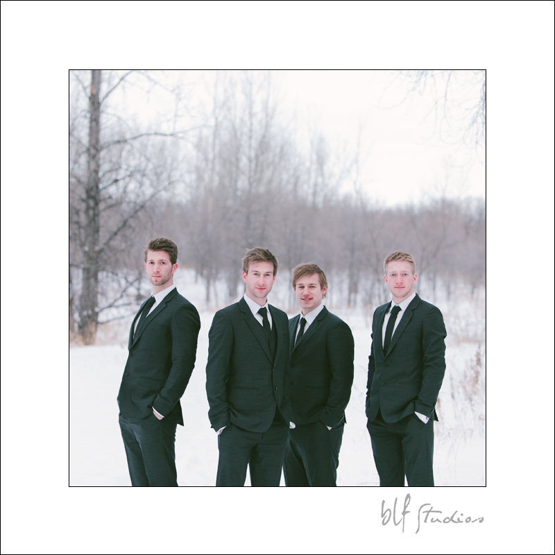 groom and groomsmen handsome in the snow.jpg