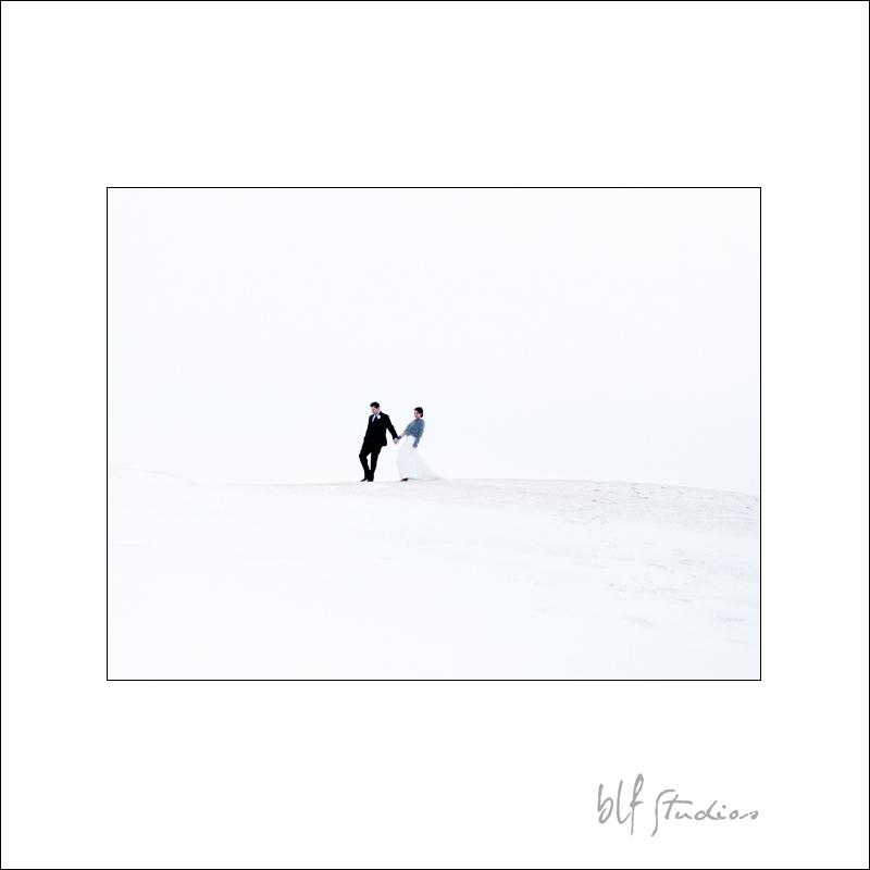 bride and groom walking in snow Winnipeg