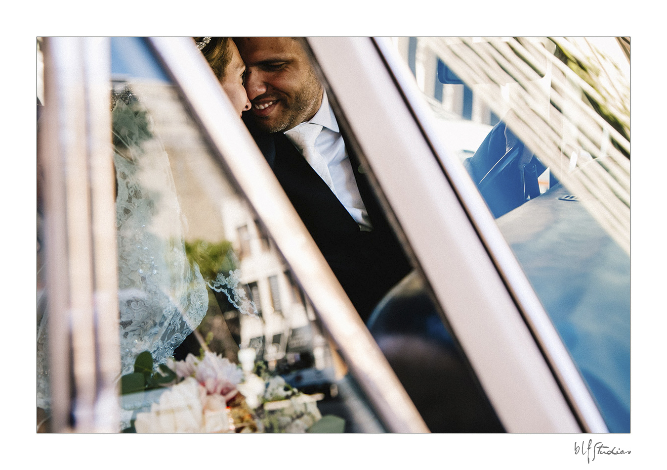 Wedding photo of bride & groom in Rolls Royce