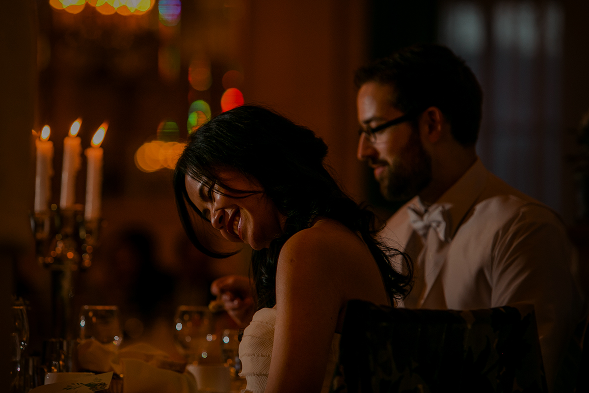 Bride laughing during wedding speeches at Hotel Fort Garry reception.jpg