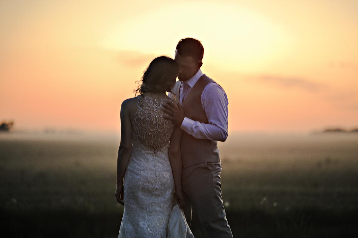 Sunset portrait of Winnipeg wedding couple
