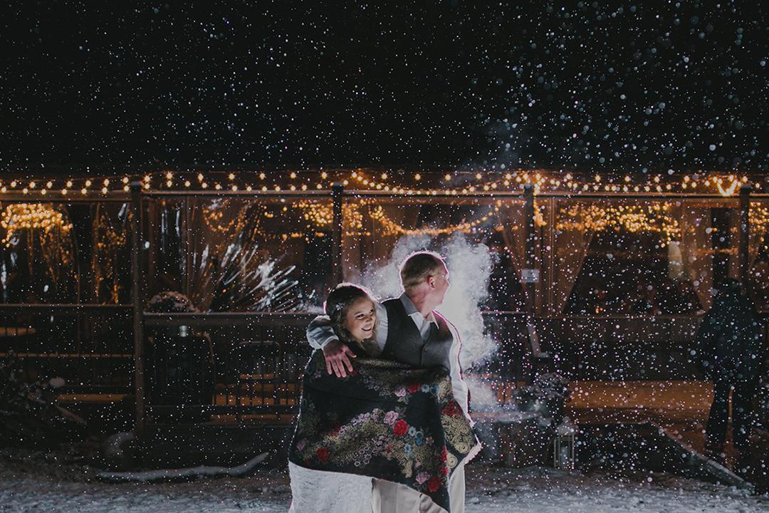 Night portraits in the snow at  La Lune Wedding Venue
