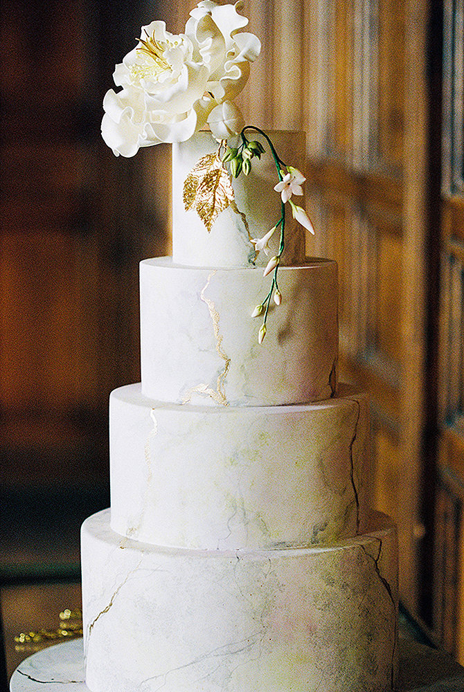 Gold leaf and pealing paint wedding cake