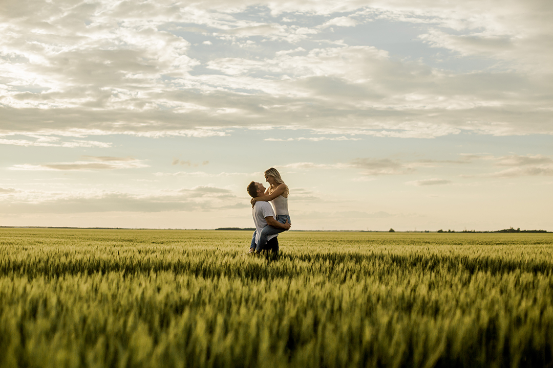 romantic engagement photos on a farm in Manitoba
