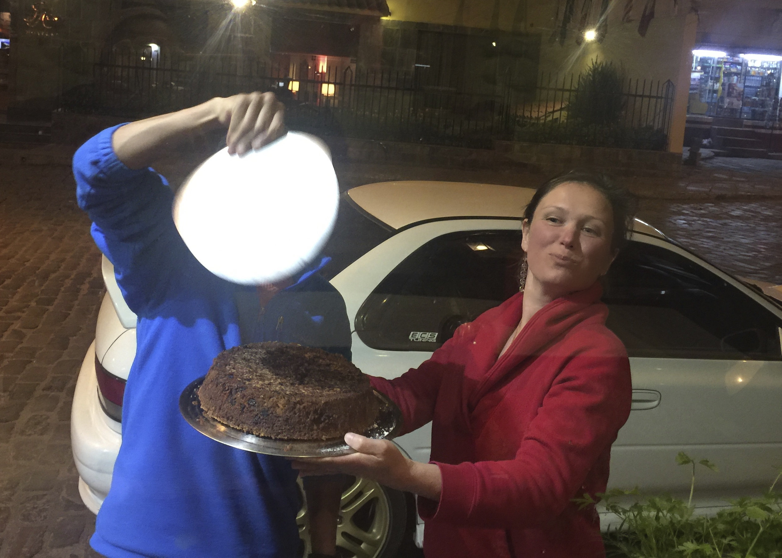 Peter & I cooling the cake outside the restaurant because we were impatient to ice the cake, and then eat it.