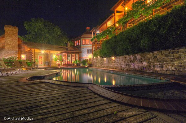 View of the pool & property at night