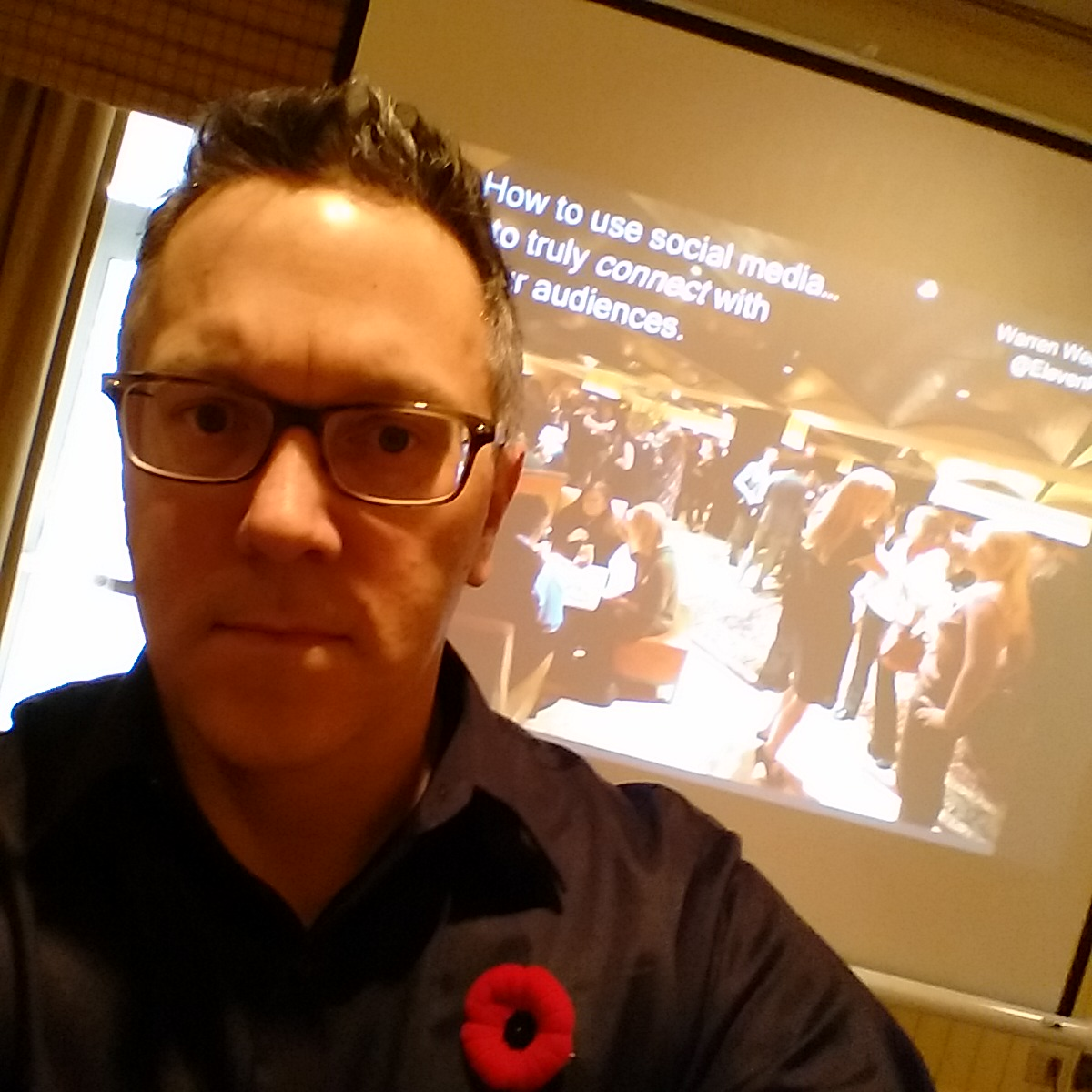 warren weeks giving a talk on how to use social media to connect with audiences at an industry conference in muskoka in november (did the poppy give it away?), 2014.