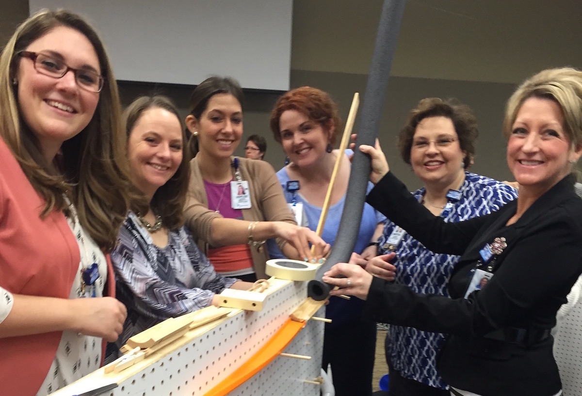 DESIGN AND BUILD GRAVITY-POWERED MARBLE MACHINES WITH CHAIN REACTION CONTRAPTIONS TEAM BUILDING EVENT