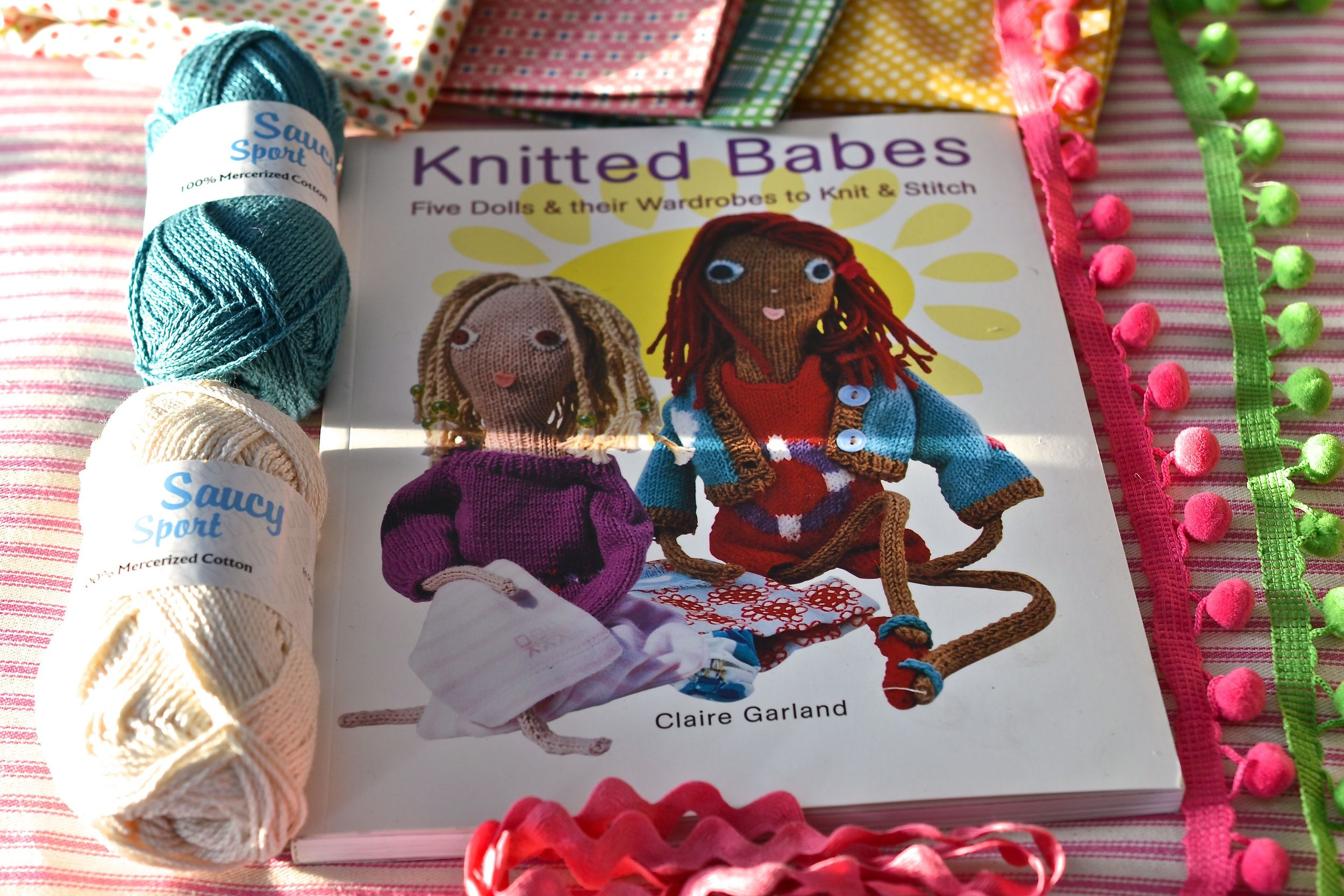 The book and materials for the babes clothes.