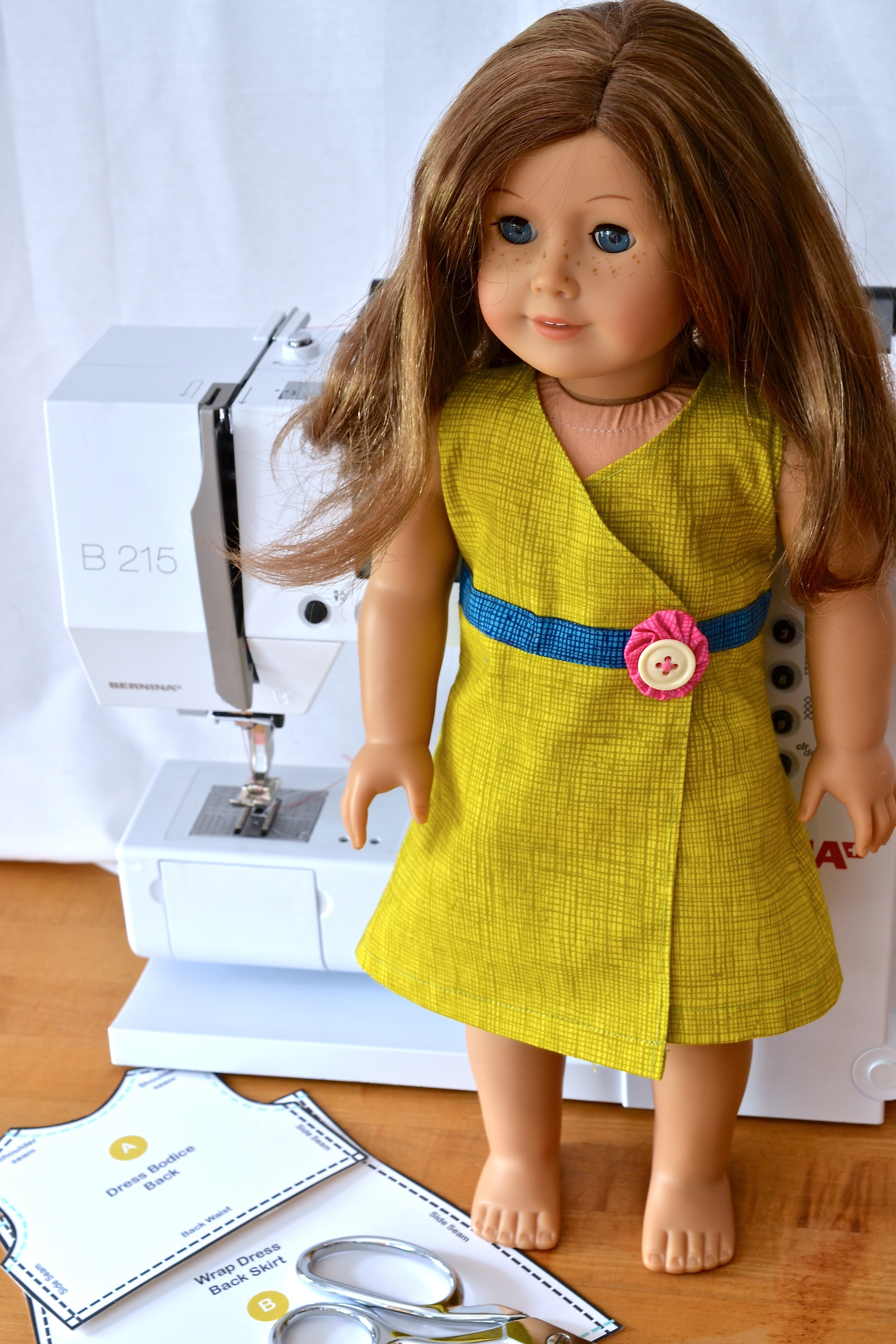 """Wrap Dress that kits American Girl sized Doll in the """"practice"""" fabric."""
